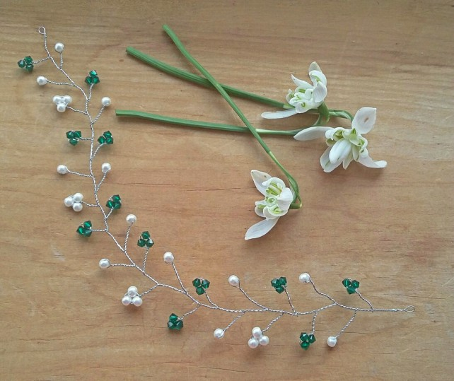 Silver hair vine adorned in white Swarovski pearls & Emerald crystals.